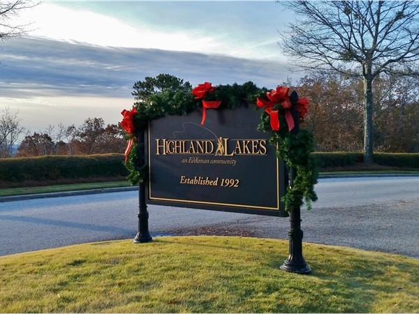 Bows and garland are placed throughout Highland Lakes by the Women's Club