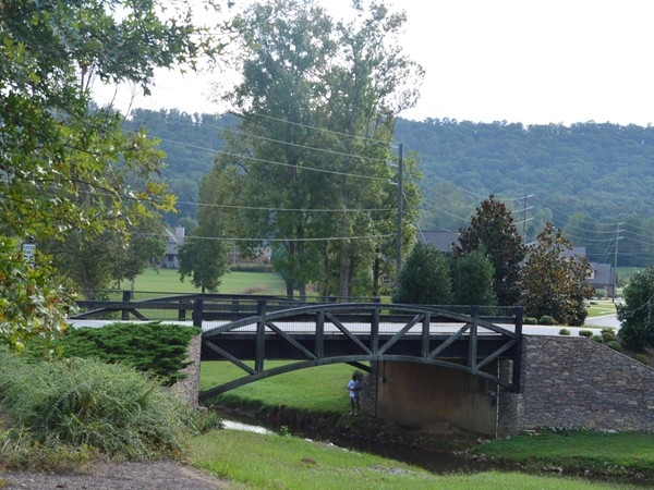 Historic style bridge leading into Legacy Springs