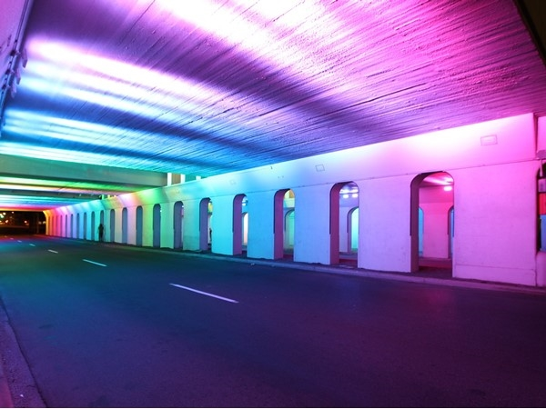The underpass of the 18th Street bridge is lit by thousands of LED lights in a rainbow of colors