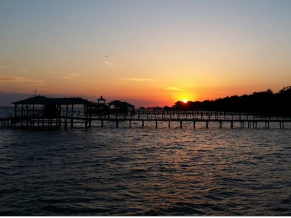 Sunset over waterfront piers on Mobile Bay, Daphne
