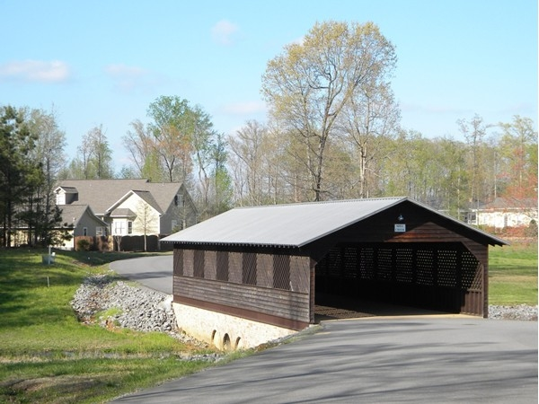 Off the beaten path is the covered bridge at the entrance to Mill Creek Village!