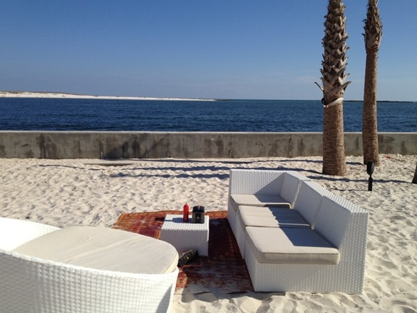 The Gulf's comfy, sandy outdoor setting on The Pass is perfect for a laid-back dinner and drinks!